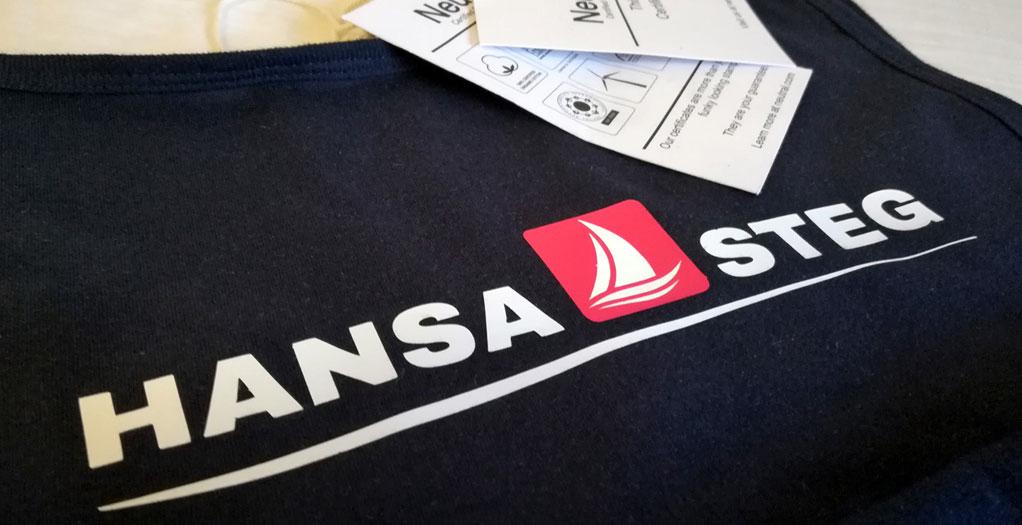 Referenz Poloshirt bedruckt mit Hansa-Steg Logo